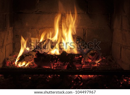 yellow flames in the fireplace - stock photo