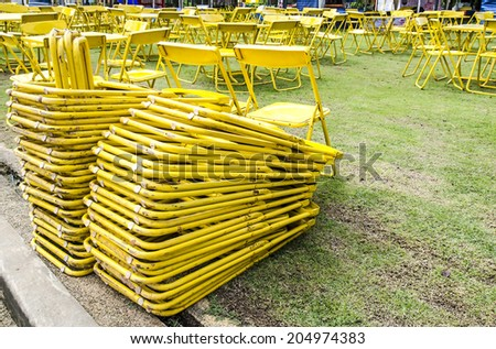 Yellow folding chair - stock photo