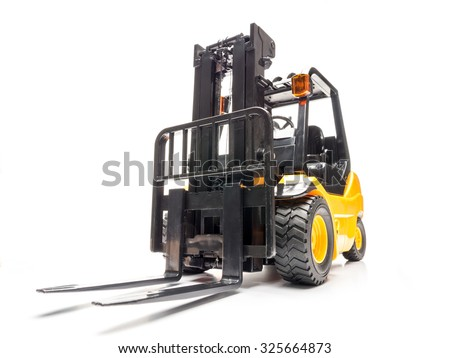 Yellow forklift truck shot on white background - stock photo