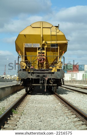 Yellow freight train cargo wagon in the train station - stock photo