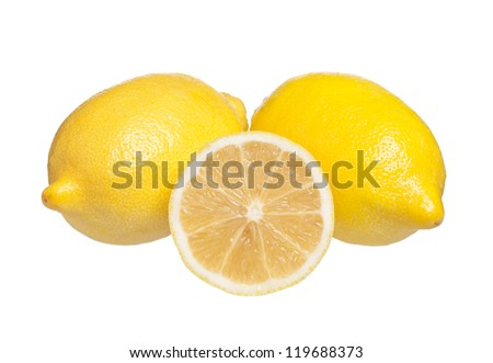 Yellow fresh lemons with half isolated on a white background - stock photo