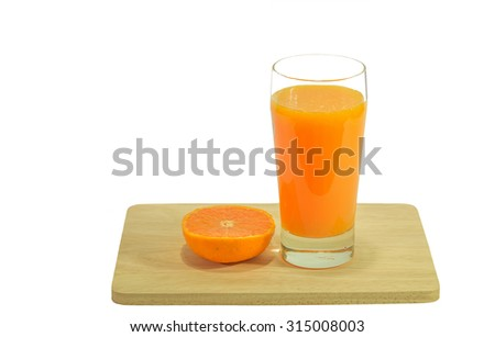 Yellow fruit juice in glass, white background. - stock photo