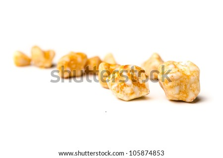 Yellow gall stones from a persons gall bladder over white background - stock photo