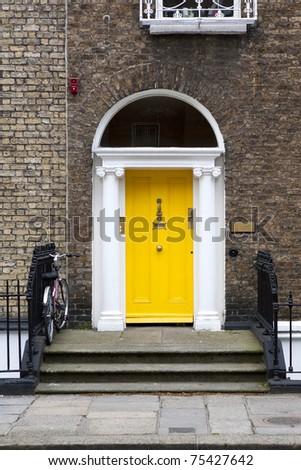 Yellow Georgian door in Dublin Ireland. - stock photo
