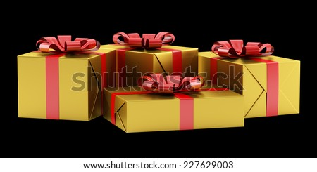 yellow gift boxes with red ribbons isolated on black background - stock photo