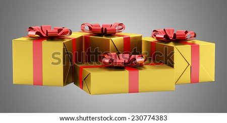 yellow gift boxes with red ribbons isolated on gray background - stock photo