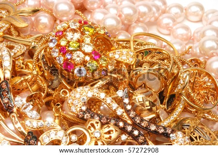 Yellow gold jewelry with stones - stock photo