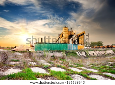 Yellow grain elevator on a concrete pedestal - stock photo