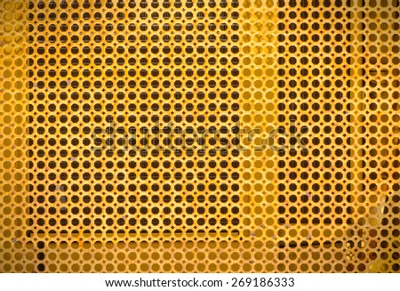Yellow grate of old backhoe - stock photo
