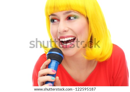 Yellow hair girl with microphone - stock photo