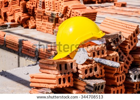 Yellow hard hat on construction site. - stock photo