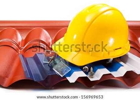 Yellow hard hat working, plastic polycarbonate roof, screws for mounting - stock photo