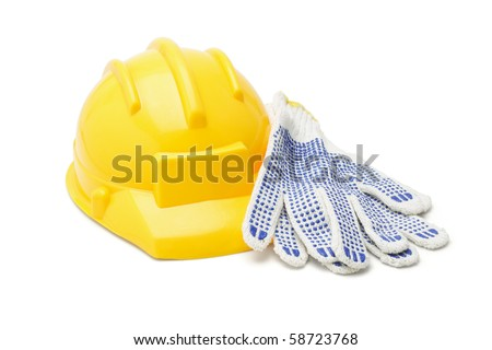 Yellow hardhat and cotton gloves on white background - stock photo