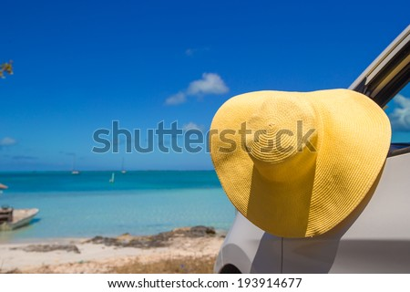 Yellow hat on the car at caribbean island - stock photo