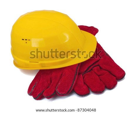 Yellow helmet and red gloves on white background - stock photo