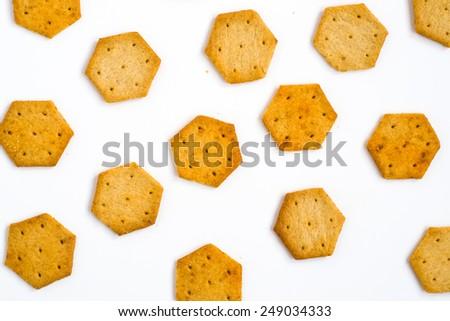 Yellow, hexagon crackers isolated on white background, closeup  - stock photo