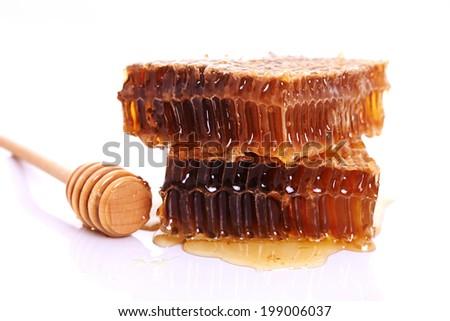 yellow honeycomb with fresh honey - stock photo
