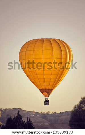 yellow hot-air balloon - stock photo