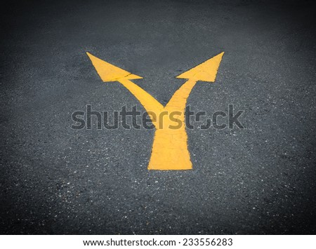yellow junction  Directional Arrow on Asphalt - stock photo