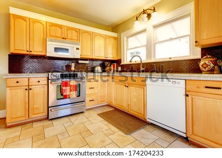 Backsplash stock photos images pictures shutterstock for White kitchen cabinets turning yellow