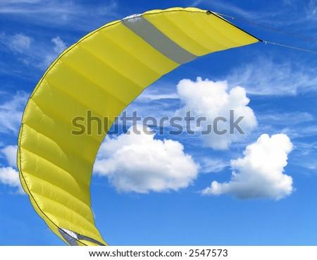 Yellow kite with three clouds - stock photo
