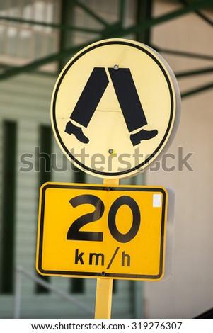 yellow 20 km speed limit sign pedestrian zone - stock photo