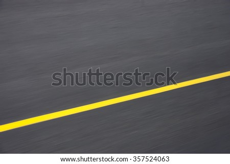 yellow lane markings on the road at a speed of - stock photo