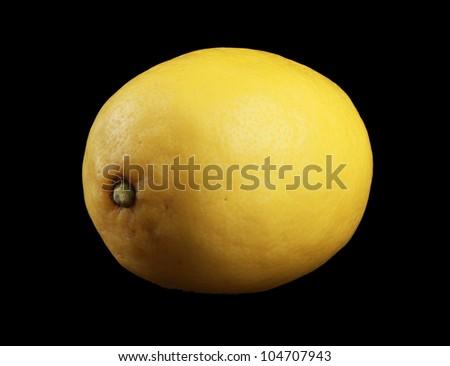 Yellow Lemon isolated on black - stock photo