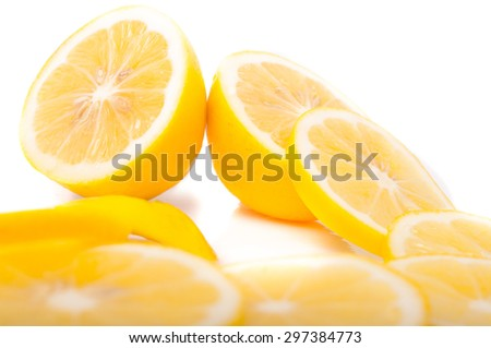 yellow Lemons and slice on a white background - stock photo