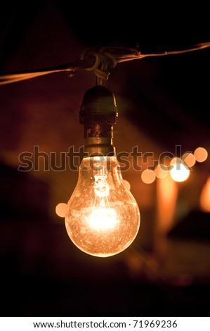 Yellow light bulb - stock photo