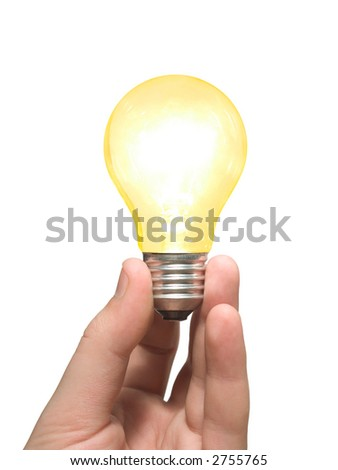 Yellow light bulb in hand, isolated on white - stock photo