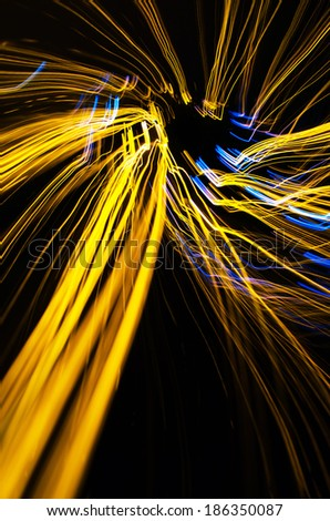 Yellow light lines at night - stock photo