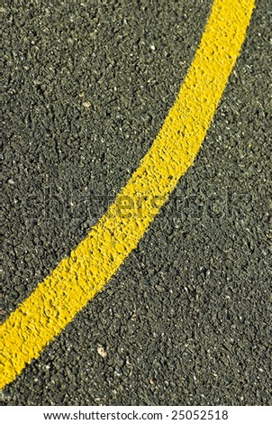 yellow line on asphalt - stock photo