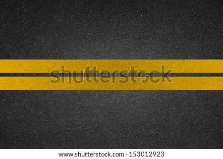 yellow line on road - stock photo