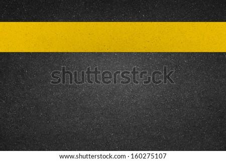 yellow line on  road - stock photo