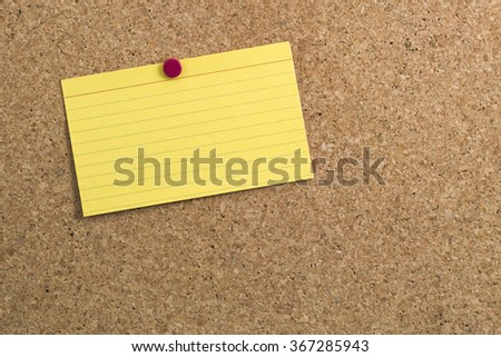Yellow Lined Index Card on Cork Board for your copy - stock photo