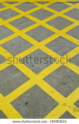 Yellow lines of a road - stock photo