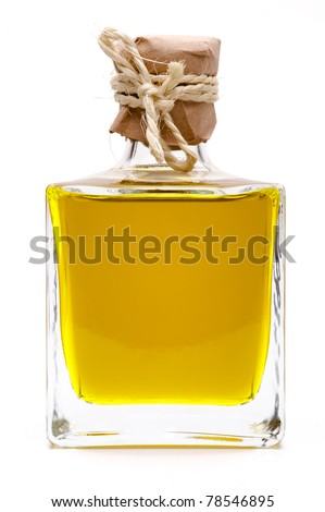 Yellow liquid, olive oil, in a small glass bottle, traditional rustic style - stock photo