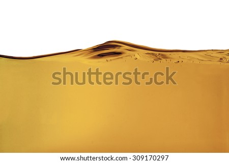 Yellow liquid with bubbles - stock photo