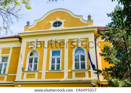 Yellow living house in Eger, Hungary - stock photo