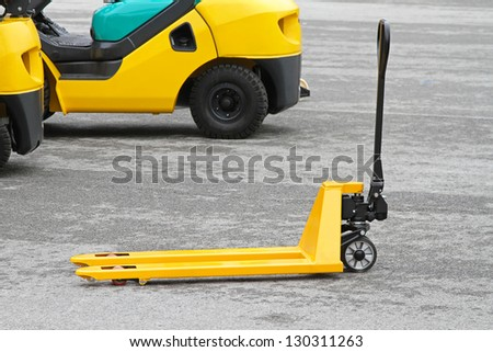 Yellow manual pallet jack  truck for transport - stock photo