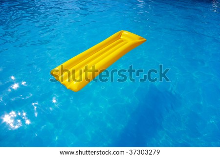 yellow mattress in the swimming pool sunny day - stock photo