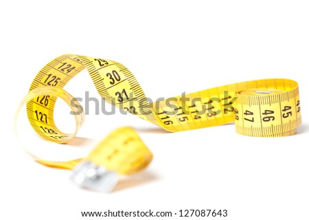 Yellow measuring tape isolated over white background - stock photo