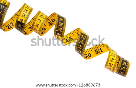 Yellow measuring tape on white with both imperial and metric systems. - stock photo