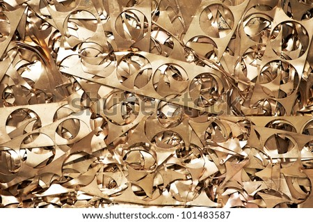 Yellow metal brass scrap materials recycling backround of punching waste - stock photo