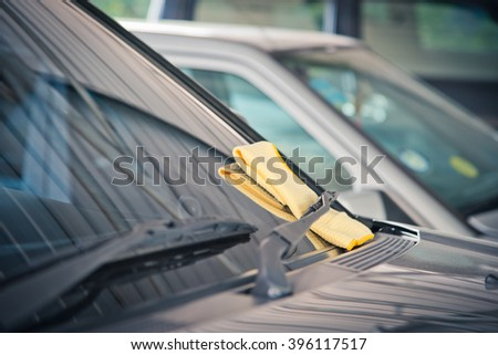 yellow microfiber cloth, cleaning glass car. - stock photo