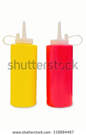 Yellow mustard and red ketchup squeeze bottles with clipping paths - stock photo