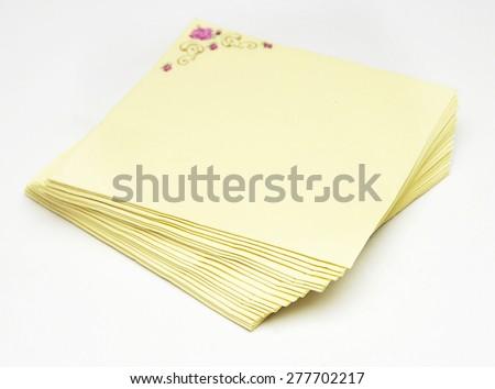 Yellow napkins in white background - stock photo