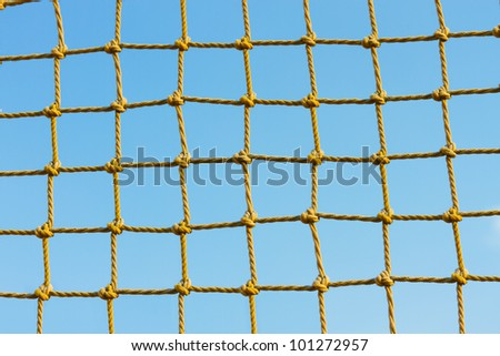 yellow net against the blue sky - stock photo