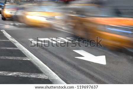 Yellow New York taxi cabs in blurred motion - stock photo
